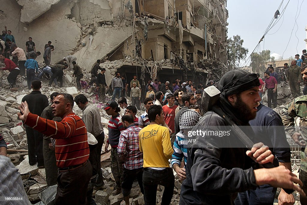 Syrians try to remove large pieces of concrete to free those trapped under the rubble following an air strike by government forces on April 7, 2013 that destroyed two five-storey apartment blocks and severely damaged ten buildings in a residential neighbourhood of the northern Syrian city of Aleppo, according to eyewitnesses. Warplanes also raided Yabrud near Damascus and Qusayr in the central province of Homs, as tanks shelled rebel enclaves in Homs city the same day.