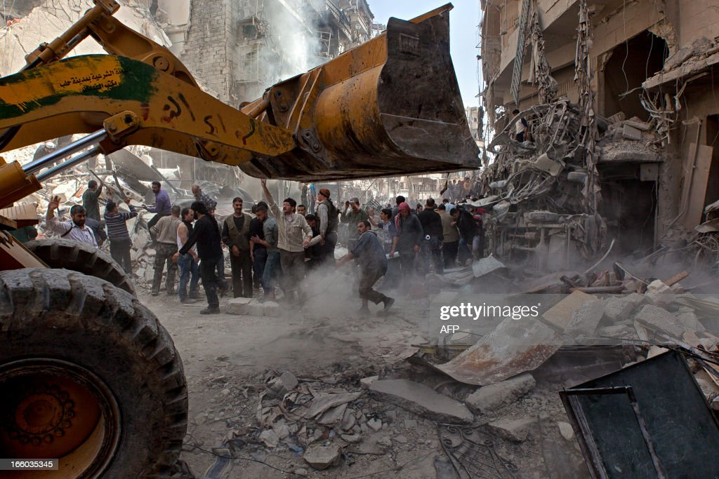 Syrians try to remove large pieces of concrete with the help of a tractor to free those trapped under the rubble following an air strike by government forces on April 7, 2013 that destroyed two five-storey apartment blocks and severely damaged ten buildings in a residential neighbourhood of the northern Syrian city of Aleppo, according to eyewitnesses. Warplanes also raided Yabrud near Damascus and Qusayr in the central province of Homs, as tanks shelled rebel enclaves in Homs city the same day.