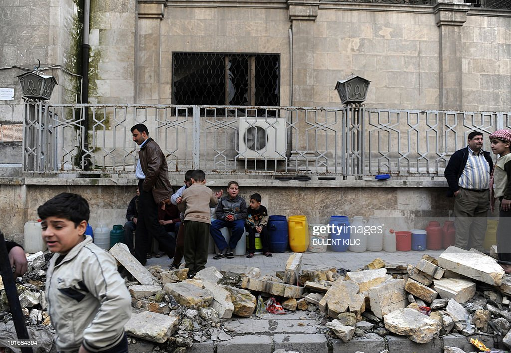 Syrians wait in line for water in the northern city of Aleppo on February 14, 2013. Syrian Foreign Minister Walid al-Muallem and opposition National Coalition chief Ahmed Moaz al-Khatib will make separate visits to Moscow for talks in the coming weeks, a top Russian diplomat said.