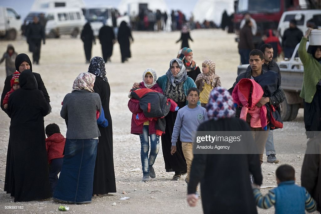 Syrians, who fled bombing in Aleppo, are seen at a tent city close to the Bab al-Salam border crossing on Turkish-Syrian border near Azaz town of Aleppo, Syria on February 10, 2016. Russian airstrikes have recently forced some 40,000 people to flee their homes in Syrias northern city of Aleppo.