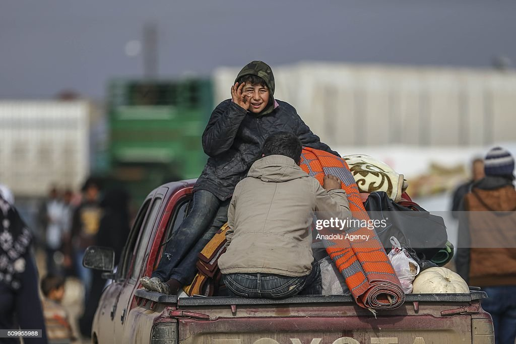 Syrians, who fled bombing in Aleppo, take humanitarian aids and rush mats which were distributed by Turkish humanitarian aid organizations at a tent city close to the Bab al-Salam border crossing on Turkish-Syrian border near Azaz town of Aleppo, Syria on February 13, 2016. Russian airstrikes have recently forced some 40,000 people to flee their homes in Syrias northern city of Aleppo.