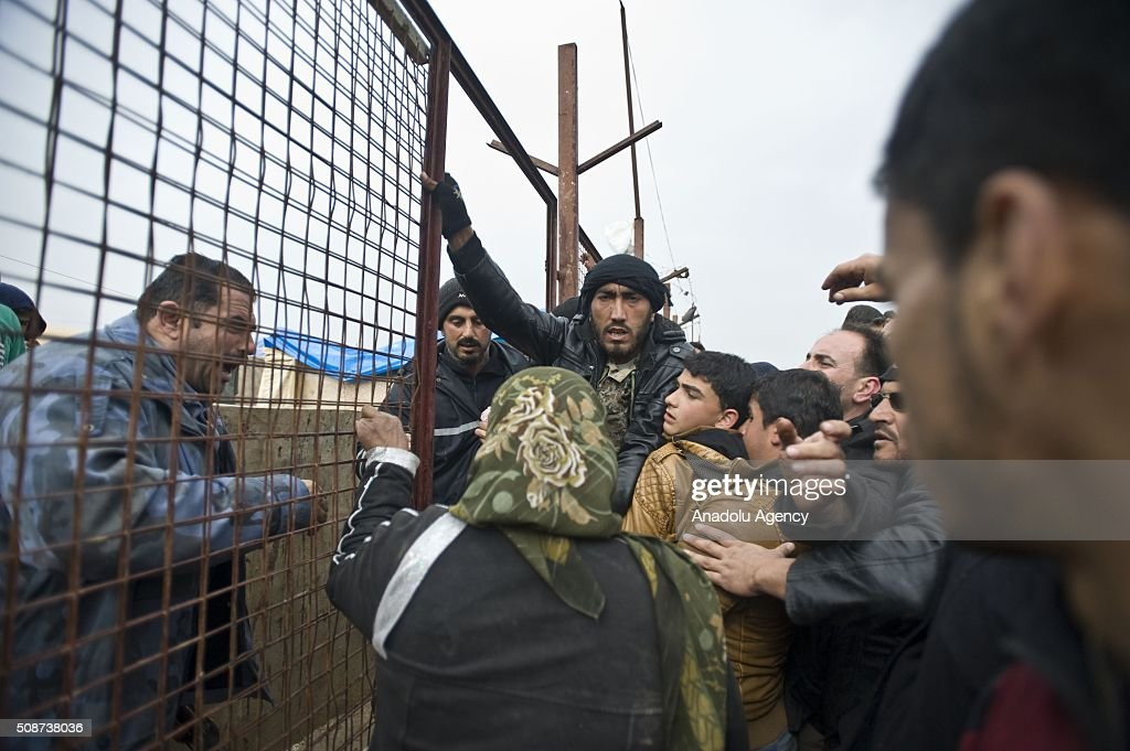 Syrians who fled bombing in Aleppo, try to get into a tent city on their way to the Bab al-Salam crossing, opposite the Turkish province of Kilis, near Azaz town of Aleppo, Syria on February 6, 2016. Thousands of Syrians have massed on the Syrian side of the border seeking refuge in Turkey.