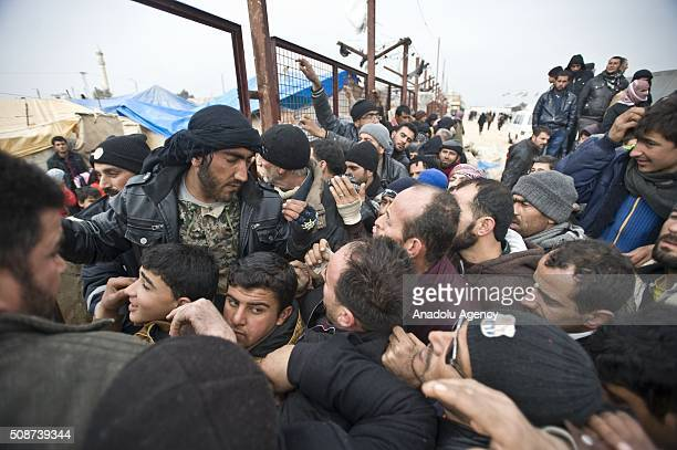 Syrians who fled bombing in Aleppo try to get into a tent city on their way to the Bab alSalam crossing opposite the Turkish province of Kilis near...