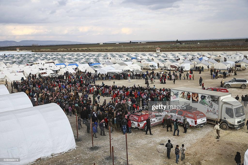 Syrians, who fled bombing in Aleppo, wait in a queue to get food at a tent city and close to the Bab al-Salam border crossing on Turkish-Syrian border near Azaz town of Aleppo, Syria on February 10, 2016. Russian airstrikes have recently forced some 40,000 people to flee their homes in Syrias northern city of Aleppo.