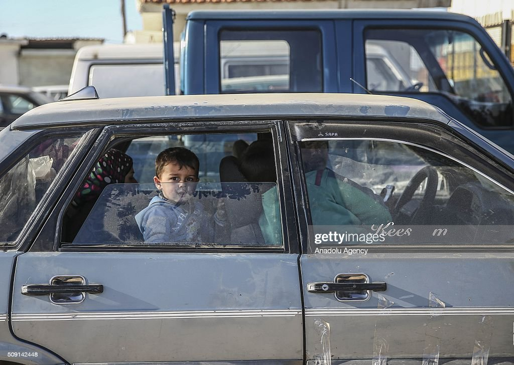 Syrians who flee the attacks of Assad Regime and Russian air forces, try to live inside their vehicle, at a refugee camp at the Bab al-Salameh border crossing on Turkish-Syrian border near Azaz town of Aleppo, Syria on February 09, 2016.