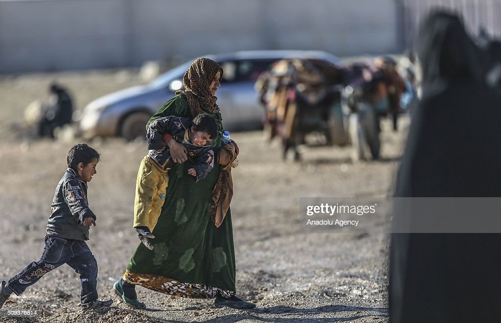 Syrians who flee the attacks of Syrian and Russian air forces, shelter at tents and try to live their lives with humanitarian aid send by Turkey, UNHCR and other Turkish Humanitarian aid organizations, close to the Bab al-Salameh border crossing on Turkish-Syrian border near Azaz town of Aleppo, Syria on February 10, 2016.