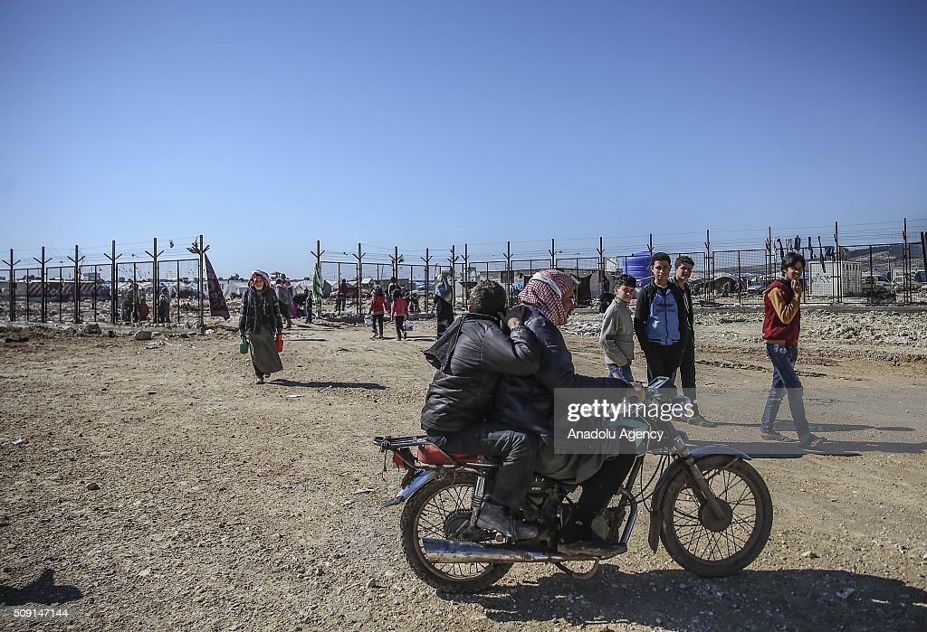 Syrians who flee the attacks of Syrian and Russian air forces to residential areas on Hayan, Haritan, Kafr, Anadan, Kafr Naya, Mayir and Ihris districts of Syria, try to live at tents and open areas at the Bab al-Salameh border crossing on Turkish-Syrian border near Azaz town of Aleppo, Syria on February 09, 2016.