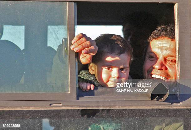 Syrians who were evacuated from rebelheld neighbourhoods in the embattled city of Aleppo arrive in the oppositioncontrolled Khan alAassal region west...