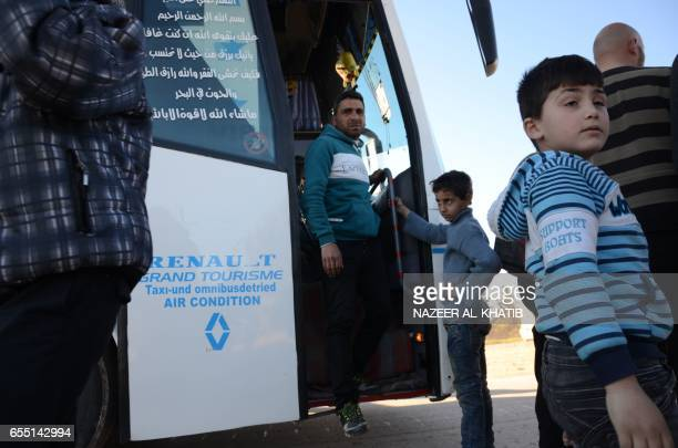 Syrians who were evacuated from Waer the last oppositionheld district of Homs arrive in the northern Syrian town of alBab on March 19 under a...