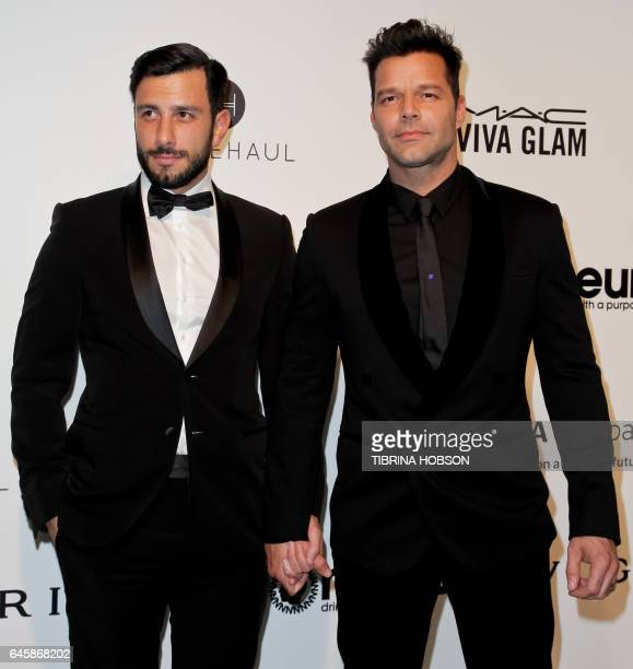 SyrianSwedish artist Jwan Yosef and Porto Rico's Ricky Martin pose upon their arrival for the 25th annual Elton John AIDS Foundation's Academy Awards...