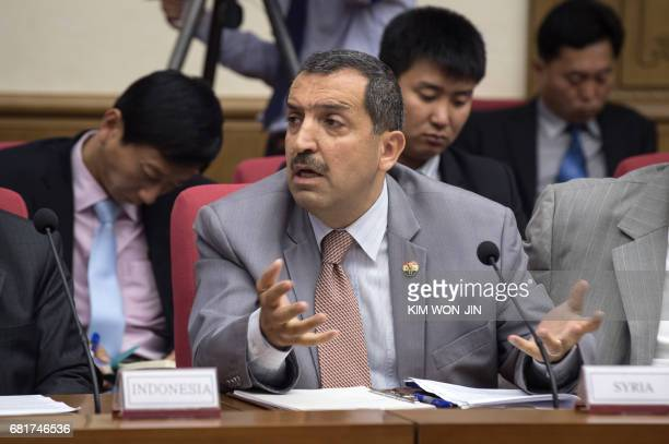 Syria's ambassador to North Korea Tamman Sulaiman speaks as North Korea's vice foreign minister Han Song Ryol gives a briefing to foreign dipomats...