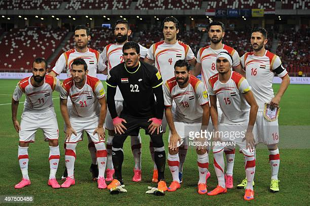 Syria's football players pose for a group photograph prior to their 2018 FIFA Group E World Cup qualifier football match against Singapore in...