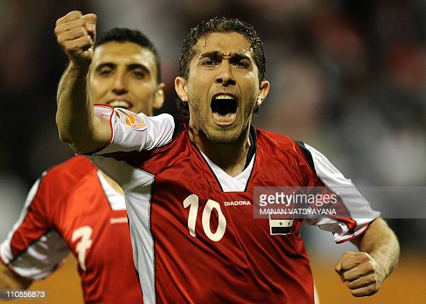 Syria's forward Firas alKhatib celebrates after scoring a goal against Japan during their 2011 Asian Cup group B football match at Qatar Sports Club...