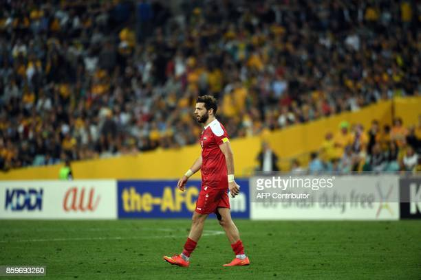 Syria's Mahmoud Al Mawas leaves the ground after receiving a red car during their 2018 World Cup football qualifying match in Sydney on October 10...