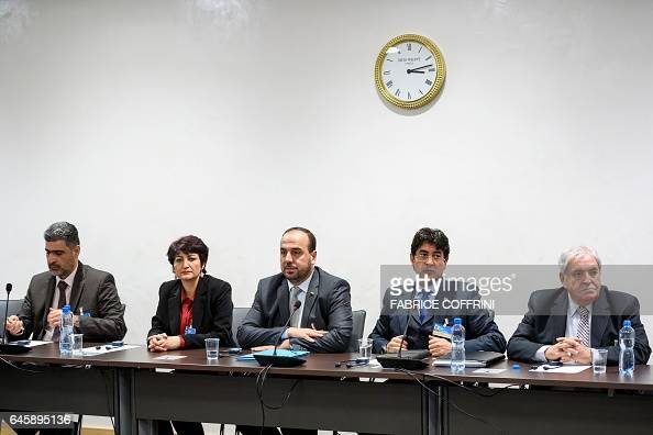 Syria's main opposition delegation with High Negotiations Committee leader Nasr alHariri attend a meeting with United Nations Syria envoy during...