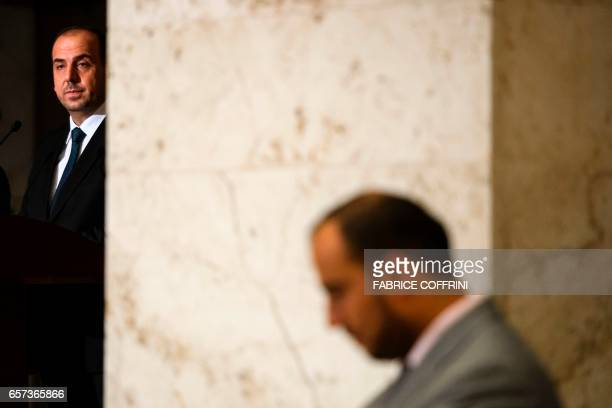 Syria's main opposition High Negotiations Committee leader Nasr alHariri attends a press conference following a meeting on Syria peace talks with UN...