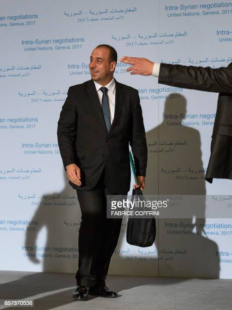 Syria's main opposition High Negotiations Committee leader Nasr alHariri reacts after a press conference following a meeting on Syria peace talks...