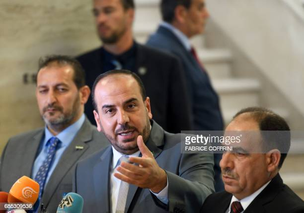 Syria's main opposition High Negotiations Committee leader Nasr alHariri gestures during a press conference following a meeting with the UN Special...