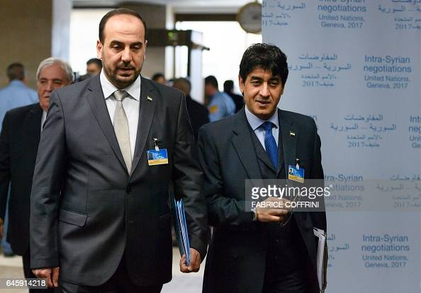Syria's main opposition High Negotiations Committee leader Nasr alHariri and member of the Syrian opposition delegation Mohamad Sabra arrive for a...