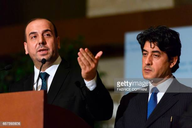 Syria's main opposition High Negotiations Committee leader Nasr alHariri gestures next to HNC chief negotiator Mohammed Sabra during a press...
