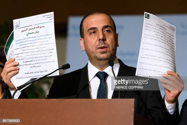 Syria's main opposition High Negotiations Committee leader Nasr alHariri shows statments during a press conference following a meeting on Syria peace...