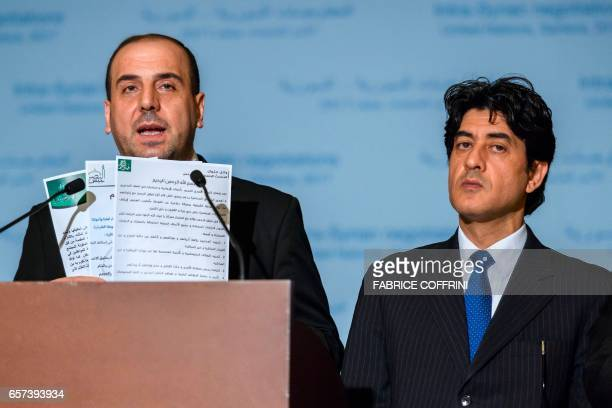 Syria's main opposition High Negotiations Committee leader Nasr alHariri shows statments next to HNC chief negotiator Mohammed Sabra during a press...