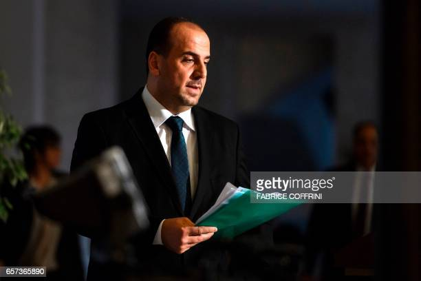 Syria's main opposition High Negotiations Committee leader Nasr alHariri arrives to a press conference following a meeting on Syria peace talks with...