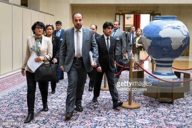 Syria's main opposition High Negotiations Committee leader Nasr alHariri arrives with members of his delegation to a meeting with the UN Special...