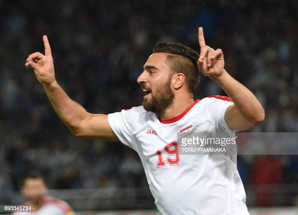 CORRECTION Syria's midfielder Mardik Mardikian reacts after scoring a goal against Japan during their friendly football match at Tokyo Stadium in...