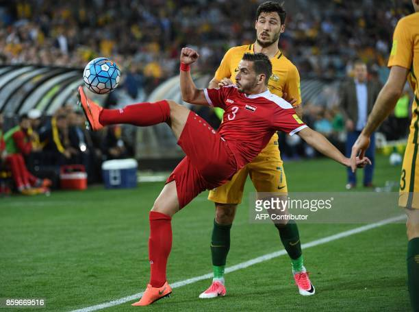 Syria's Mouaiad Ajjan fights for the ball with Australia Mathew Leckie during their 2018 World Cup football qualifying match played in Sydney on...