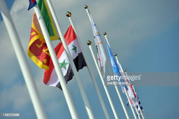Syria's national flag flies during the flag raising ceremony at the Olympic village in London on July 25 two days before the start of the London 2012...