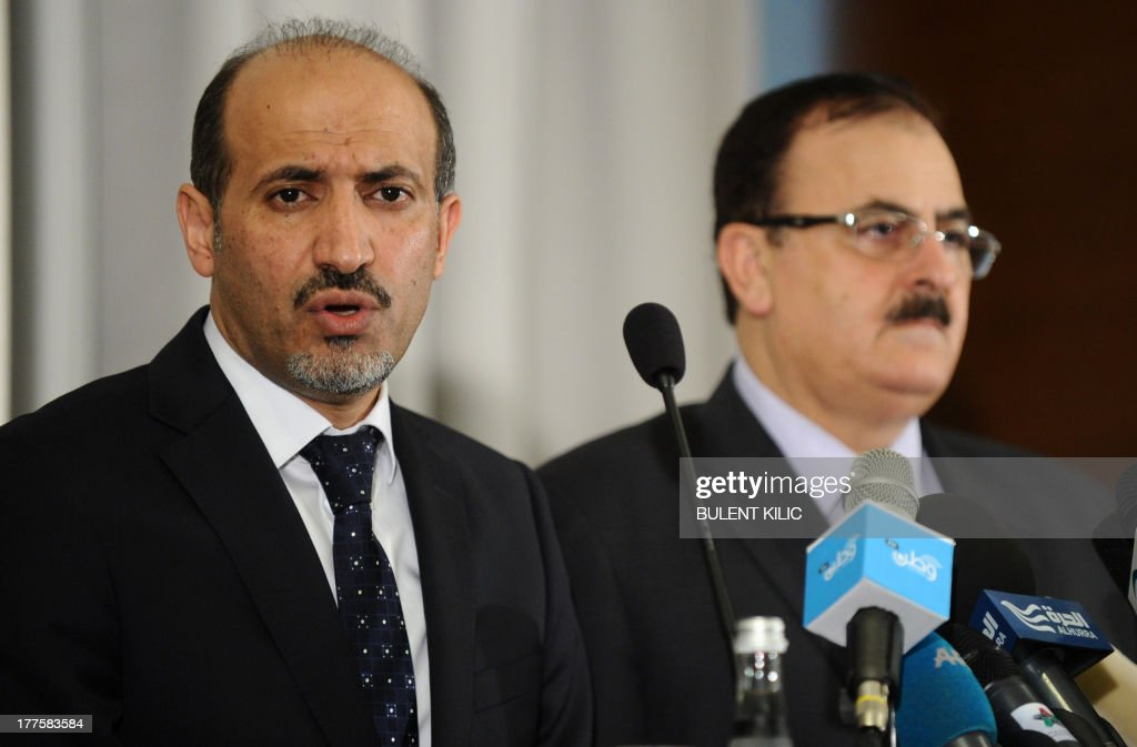 Syria's new opposition chief Ahmad Jarba speaks during a press conference with Syrian rebel leader General Salim Idris (R) on August 24, 2013 in Istanbul.