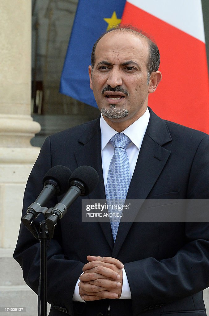 Syria's new opposition leader Ahmad Jarba speaks to the media at the Elysee presiential palace after a meeting with France President on July 24, 2013 in Paris. Jarba asked France the day before for military aid to boost the forces fighting the regime of President Bashar al-Assad.