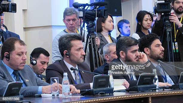 Syria's opposition HNC chief negotiator Mohammed Alloush and the opposition delegation take part in the first session of Syria peace talks in Astana...