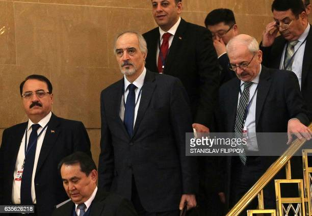 Syria's UN ambassador and head of the government delegation Bashar alJaafari Syrian ambassador to Russia Riad Haddad delegation memebers arrive prior...