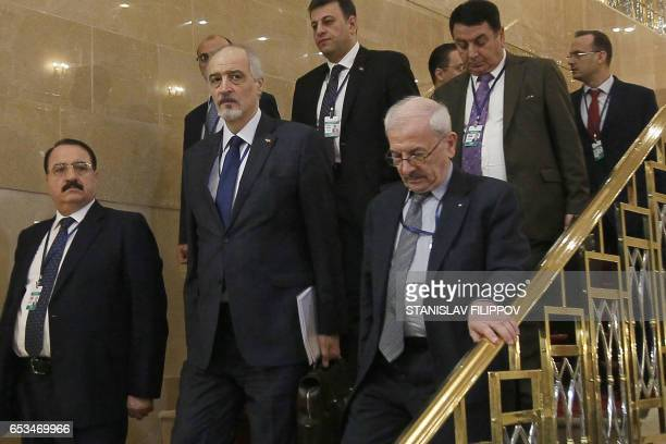 Syria's UN ambassador and head of the government delegation Bashar alJaafari Syrian ambassador to Russia Riad Haddad and other delegates arrive to...