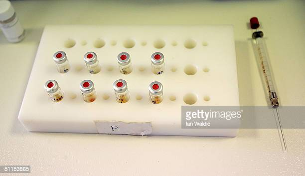 A syringe and small sample bottles are seen at the Doping Control Laboratory of Athens during the final days before the start of the 2004 Olympic...