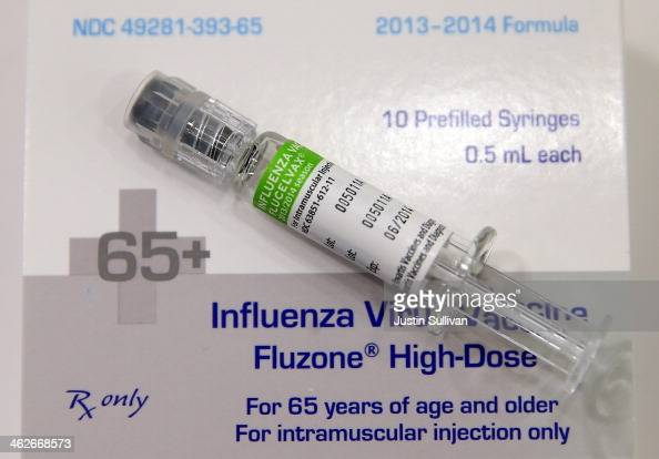 A syringe filled with influenza vaccination is seen at a Walgreens Pharmacy on January 14 2014 in Concord California Public health officials are...