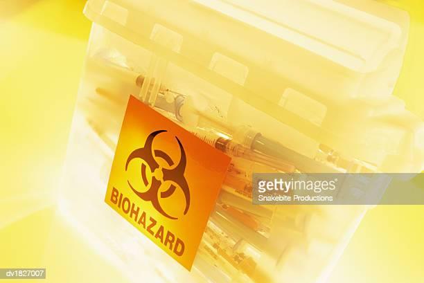 Syringes in a Bin for Biohazard Waste