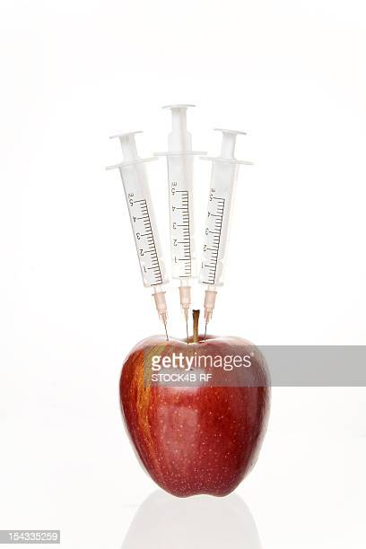 Syringes in an apple