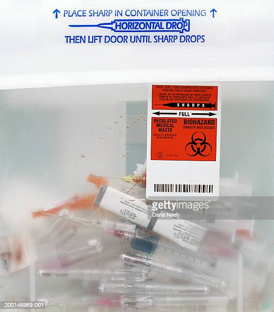 Syringes in medical waste container, close-up