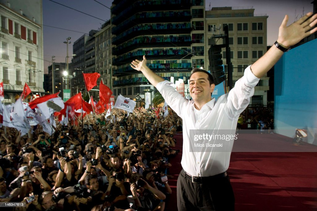 Syriza Party leader <a gi-track='captionPersonalityLinkClicked' href=/galleries/search?phrase=Alexis+Tsipras&family=editorial&specificpeople=6592450 ng-click='$event.stopPropagation()'>Alexis Tsipras</a> greets supporters during a main pre election party rally on June 14, 2012 in Athens, Greece. The Greek electorate are due to go to the polls in a re-run of the general election on June 17, 2012 after no combination of political parties were able to form a coalition government. Recent opinion polls have placed the anti-bailout party 'Syriza' equal in popularity with the pro-bailout 'New Democracy' ahead of Sunday's general election which could determine whether Greece retains the Euro as its currency.