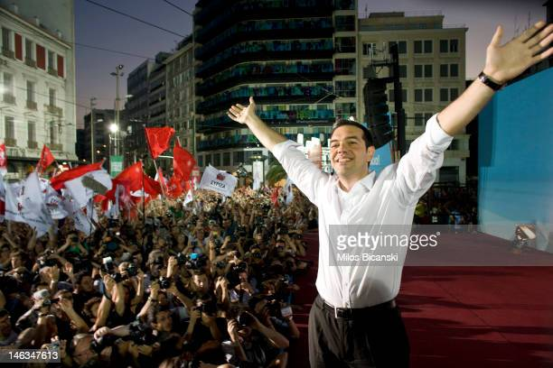 Syriza Party leader Alexis Tsipras greets supporters during a main pre election party rally on June 14 2012 in Athens Greece The Greek electorate are...