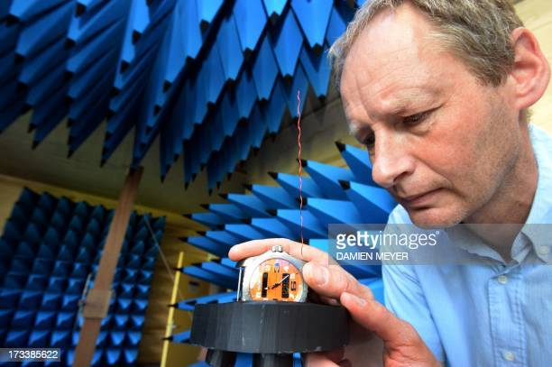 Syrlinks employee tests a watch in an anechoic chamber on july 10 2013 at Syrlinks enterprise in Bruz suburb of the western city of RennesThis watch...