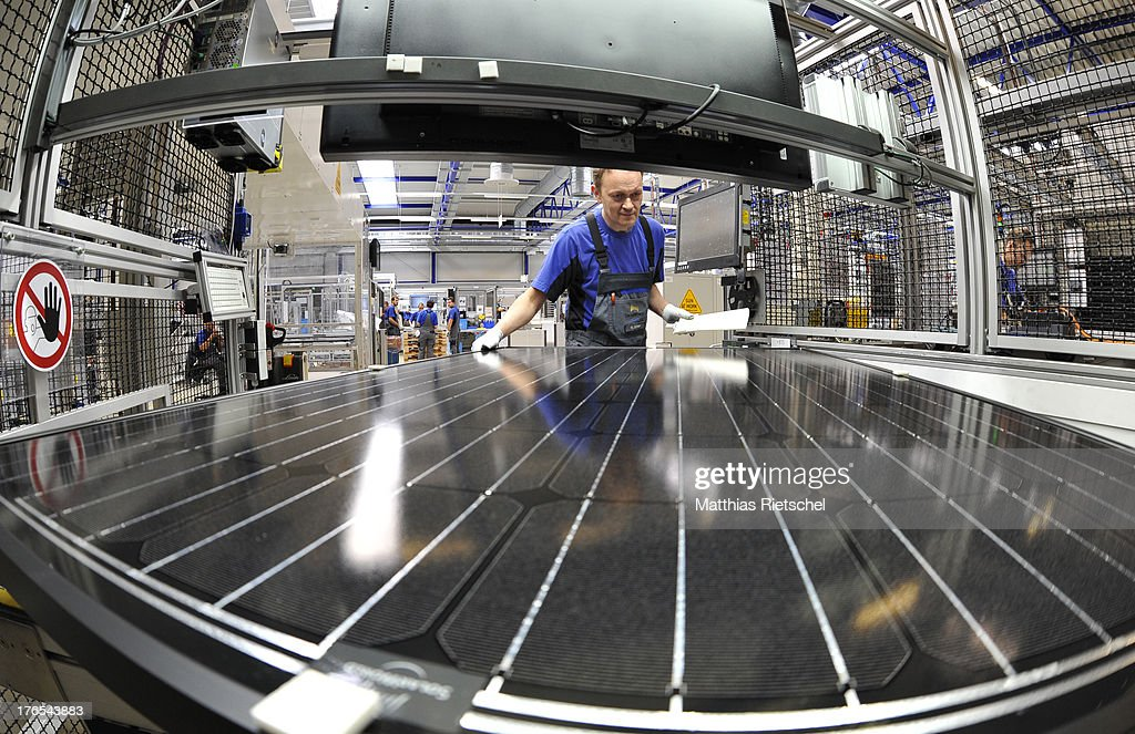 System administrator Holm Goehler checks a finished solar energy modul in the assembly line at the Solarworld plant on August 14, 2013 in Freiberg, Germany. The troubled solar cells, modules and panels producer managed to recently avoid bankruptcy by reaching an agreement with its shareholders and other investors. Many solar energy equipment producers in Germany are facing difficult times due to stiff competition from China.