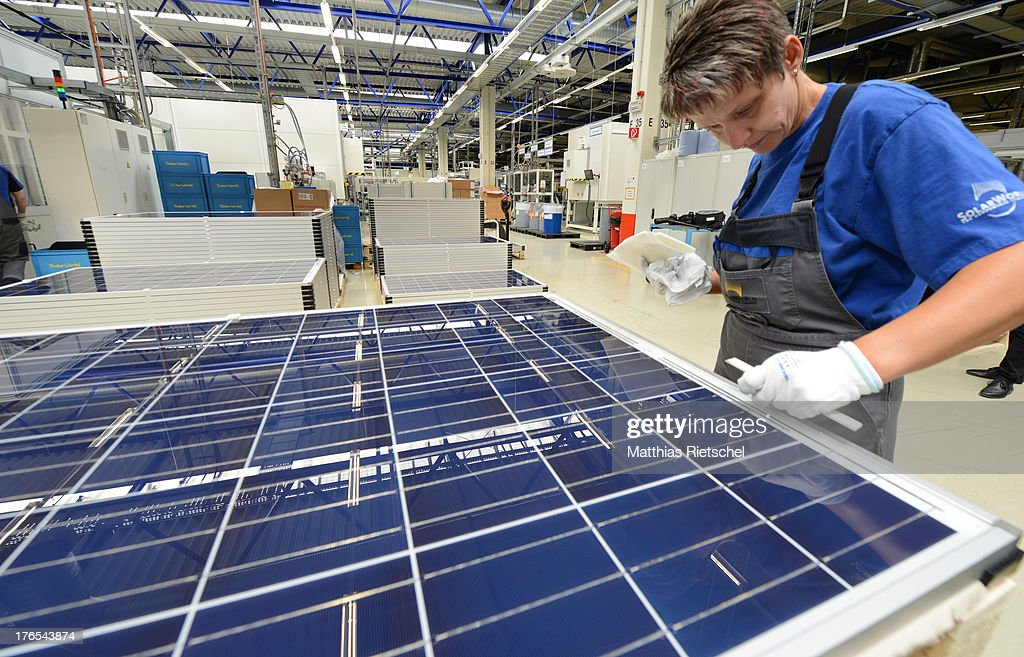 System administrator Romy Loeser checks finished solar energy moduls at the Solarworld plant on August 14, 2013 in Freiberg, Germany. The troubled solar cells, modules and panels producer managed to recently avoid bankruptcy by reaching an agreement with its shareholders and other investors. Many solar energy equipment producers in Germany are facing difficult times due to stiff competition from China.