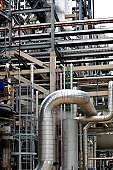 System of layered industrial pipes and ducts.