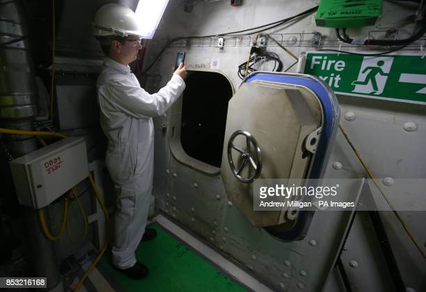 BAE Systems Phil Applegate uses the Unique QR system for navigating his way around HMS Queen Elizabeth Aircraft Carrier as work continues on the ship...