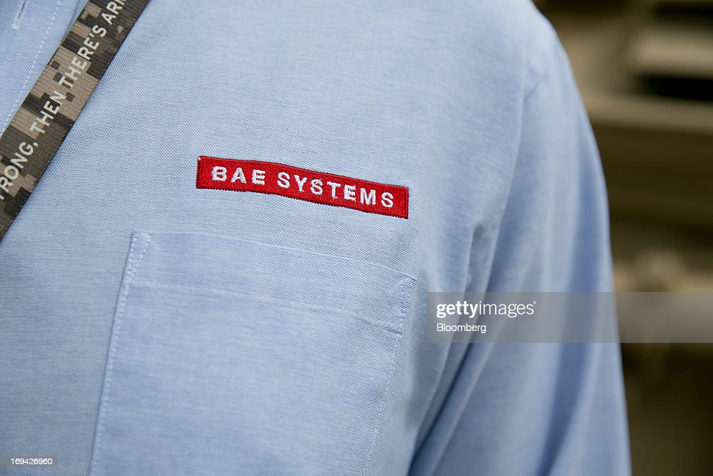 Systems Plc logo is seen on a shirt in this arranged photograph at the BAE Systems Plc Land & Armaments facility in York, Pennsylvania, U.S., on Thursday, May 23, 2013. BAE Systems Plc is deploying smaller suppliers to pressure U.S. lawmakers to speed up orders to modernize Bradley fighting vehicles, a move the company said may protect thousands of subcontractor jobs and keep a Pennsylvania assembly line open. Photographer: Andrew Harrer/Bloomberg via Getty Images