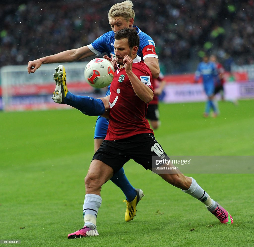 Szablocs Huszti of Hannover is challenged by Andreas Beck of Hoffenheim during the Bundesliga match between Hannover 96 and TSG 1899 Hoffenheim at AWD Arena on February 9, 2013 in Hannover, Germany.